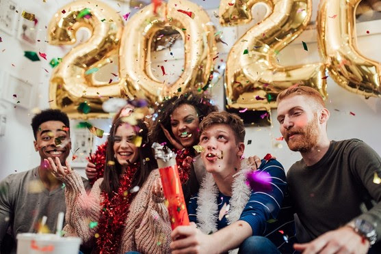 People Celebrating 2020 New Year with Confetti