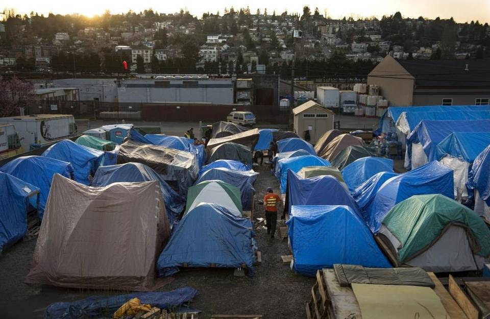 Rows of tents fill an authorized lot at Tent City 5 in the Interbay neighborhood of Seattle. Sacramento officials toured the city-sanctioned homeless camp as they consider whether to authorize a similar one in the capital.