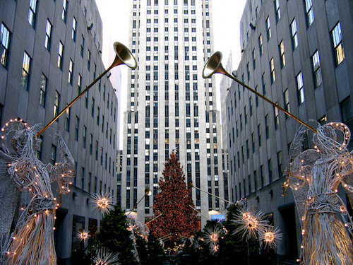 famous Rockefeller Center Christmas tree in New York, USA, surrounded by light up Christmas angels