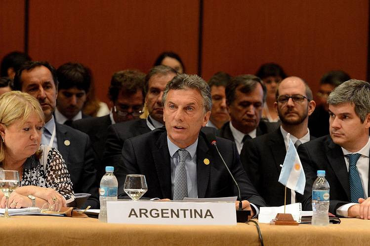 In his first two weeks as president, Mauricio Macri has removed most agricultural export taxes, cut personal income taxes, and announced a $500 million shale-oil investment.
