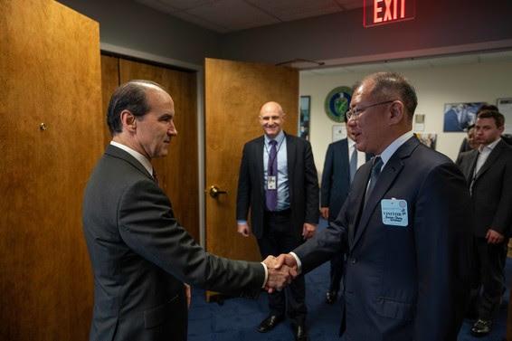 Under Secretary of Energy Mark Menezes and Hyundai Motor Group Executive Vice Chairman Euisun Chung shake hands