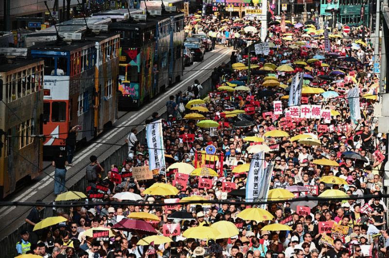 The demonstration comes just days after four prominent leaders of Hong Kong's democracy movement were jailed for their role in organising mass pro-democracy protests in 2014.
