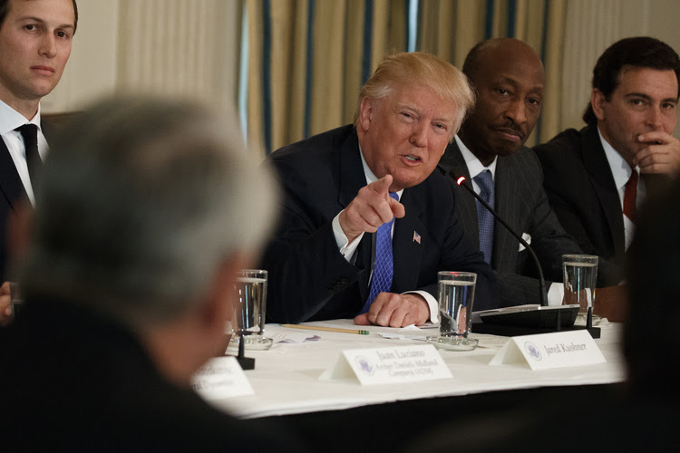 Trump speaks to business leaders, including Merck CEO Kenneth Frazier, at the White House. (Evan Vucci/AP)