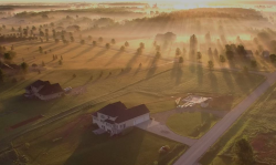photo from the sky of a sunrise over a rural community