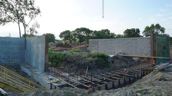 Retaining wall construction continues in the Opus area.