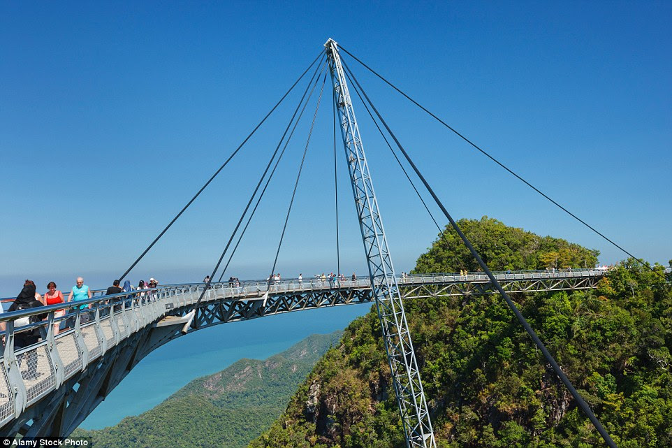 Completed in                                                      2004, the Langkawi                                                      Sky Bridge is                                                      built on top of                                                      the Machinchang                                                      mountain in                                                      Malaysia and hangs                                                      at about 328 ft                                                      above the ground.                                                      The walkway can                                                      accommodate up to                                                      250 people at the                                                      same time and                                                      swings out over                                                      the landscape to                                                      give visitors a                                                      unique look at the                                                      landscape