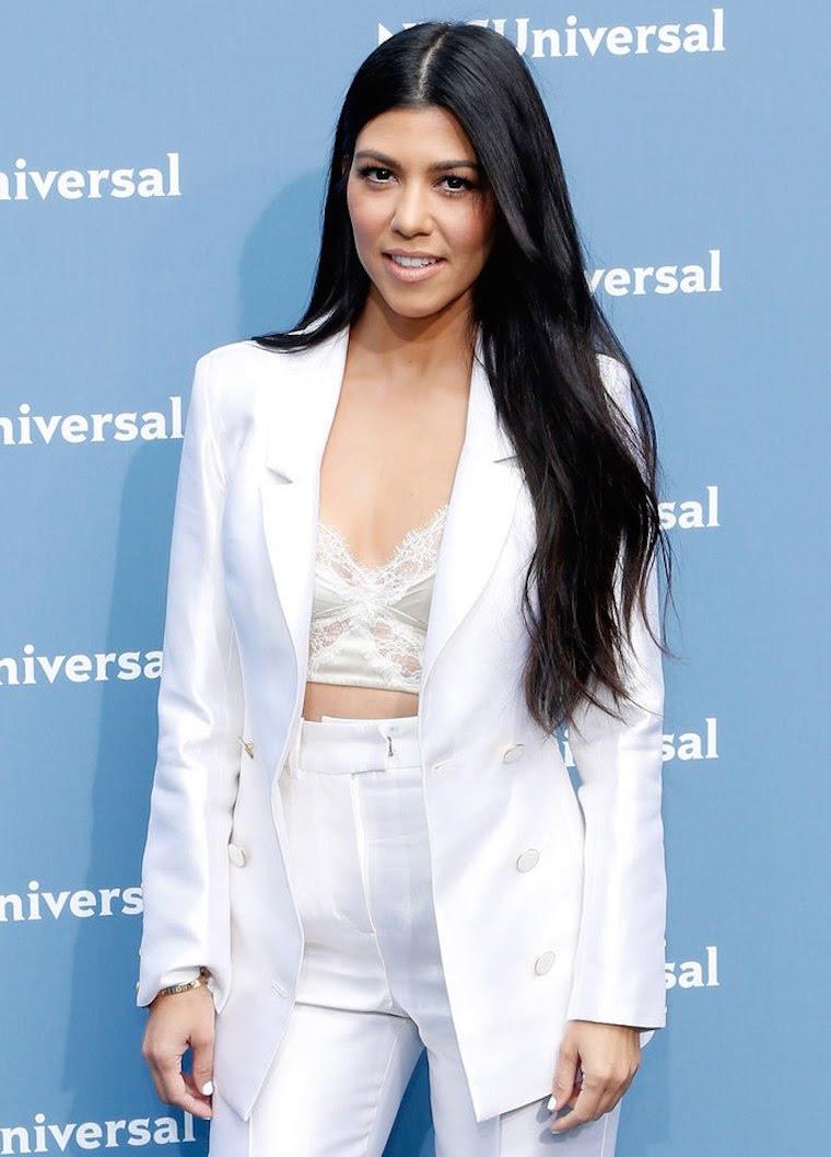 Kourtney Kardashian in an all-white apparel.