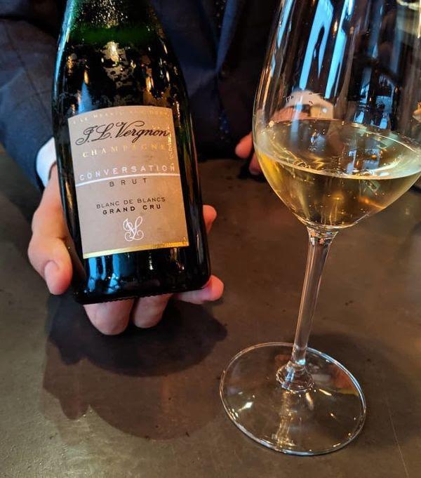 Bottle and glass of Champagne Brut Grand Cru Conversation Blanc de Blancs by JL Vergnon