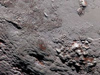 NASA released the sharpest photos of Pluto in history — and they're spectacular
