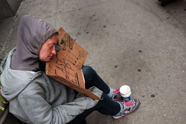 """<span class='image-component__caption' itemprop=""""caption"""">NEW YORK, NY - MAY 18: A homeless woman rests while panhandling along Eighth Avenue in Manhattan on May 18, 2015 in New York City. As many parts of once seedy New York City have been transformed into family and shopping friendly environments, 8th Avenue near the Port Authority bus station is one of the last hold-outs to old gritty Manhattan. Last week a man was shot by police after he attacked numerous people with a hammer along a stretch of the street. There is a high police presence along the street and fights and arrests for vagrancy are common.</span>"""