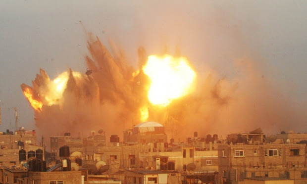 A ball of fire is seen following an early morning Israeli air strike, on Rafah in the southern of Gaza strip.