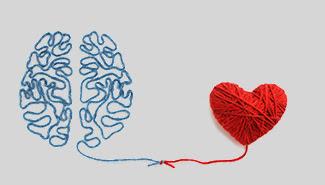 Brain made of yarn tethered to a heart made of yarn