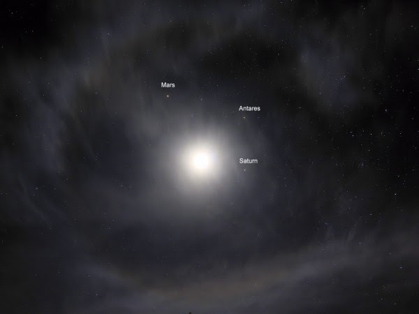 View larger. | Halo around the moon with Mars, Antares and Saturn sheltering inside it, Photo by Stephen Marceau in Eastern Australia, March 2, 2016.