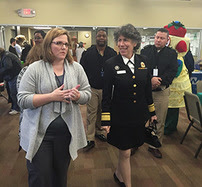 Dr. Lurie and Jori July from the Genesee County Health Department tour a where people can go to get their blood lead levels checked.