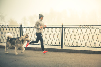 Woman jogging with dog