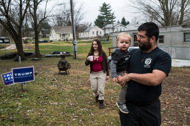 Matthew Heimbach, who runs the Traditionalist Worker Party, at home in Paoli, Ind., with his son and wife. His group advocates replacing the United States with nation-states based on ethnicity and religion.