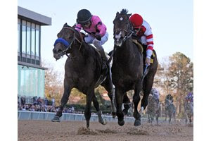 Omaha Beach (inside) upsets Game Winner to win the second division of the March 16 Rebel Stakes at Oaklawn Park