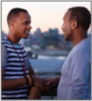 2 Black men conversing