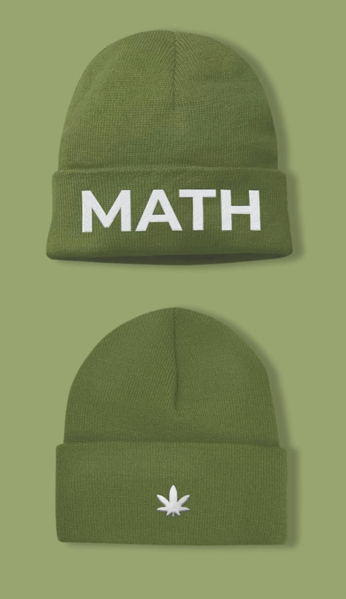 Green beanie with math embroidered in white in the front and marijuana leaf on the back