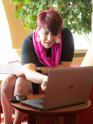 Woman pointing something out on laptop screen