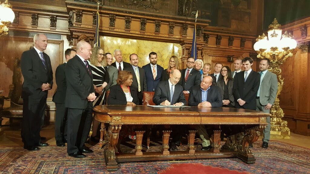 Gov. Wolf signs executive order to protect LGBT people from discrimination at work in state jobs