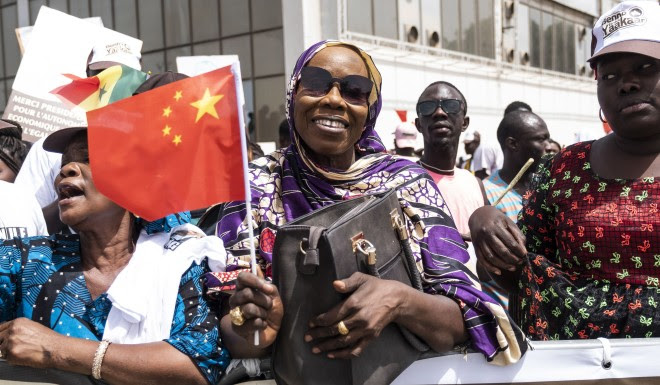 Senegal residents welcome Xi Jinping in capital city Dakar after the Chinese president arrives on July 21.