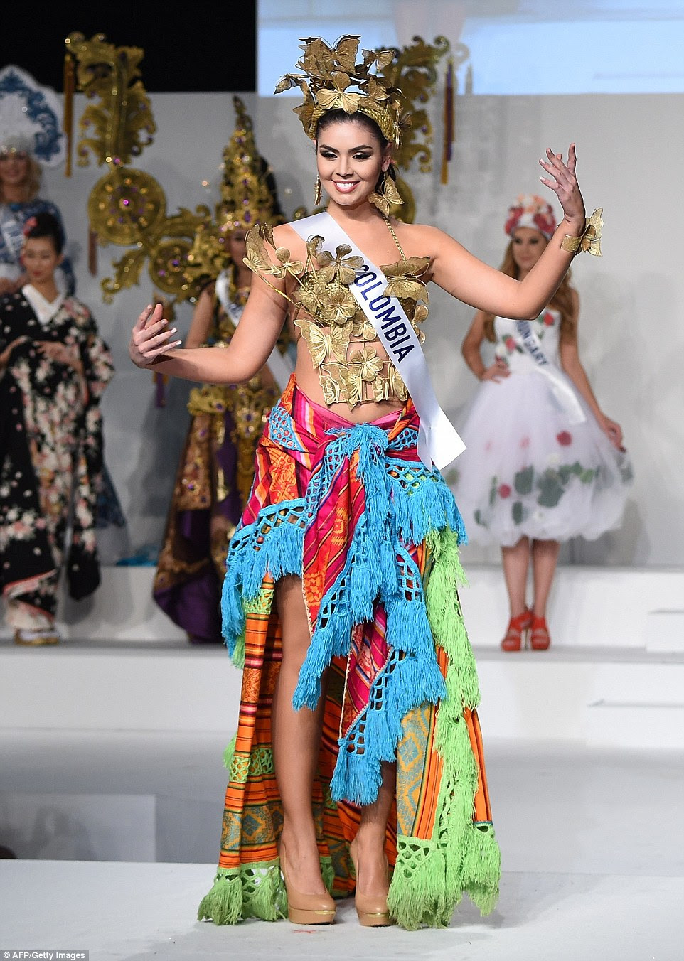 Miss Colombia appeared to take a classically colourful patterned blanket and tie it around her waist to wear as a skirt. We'll wait for that one to catch on - or perhaps she had a wardrobe malfunction with her original skirt? Either way Natalia Ochoa Calle's top and crown had a bit more effort put into them, adorned with sparkly gold butterflies and flowers