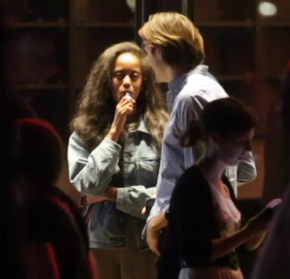 Malia, 20, puffed on an e-cigarette as they made their way out of The Bridge Theatre. Her father, Barack, was also a regular smoker prior to entering the White House and was spotted several times chewing on nicorette gum to fight the habit