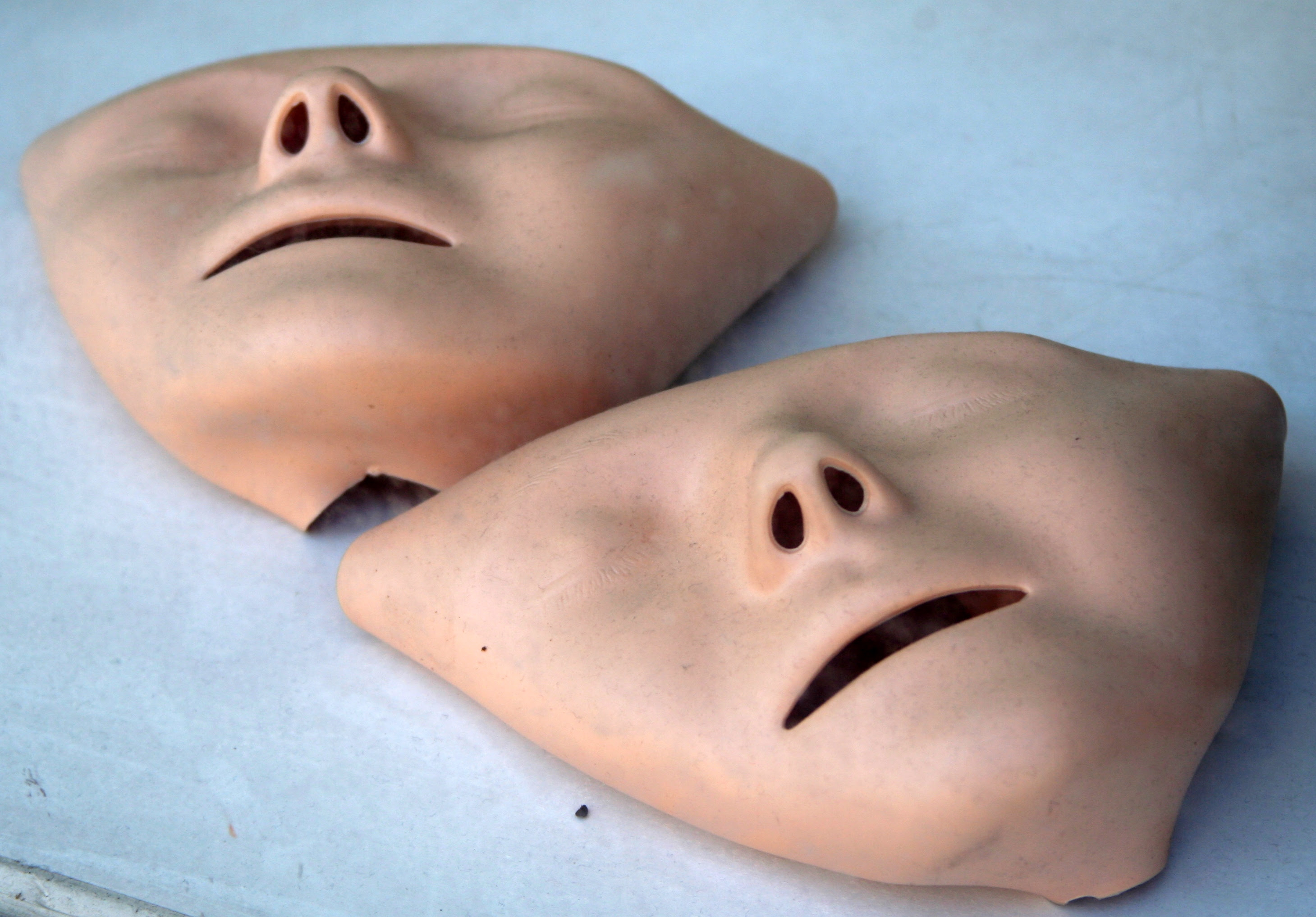 http://upload.wikimedia.org/wikipedia/commons/8/80/First_aid_masks_for_CPR_training.jpg