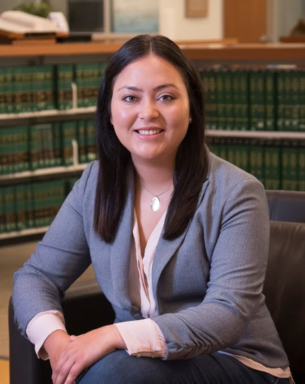 UMKC Law student, Elsa Linares, sitting in the law library