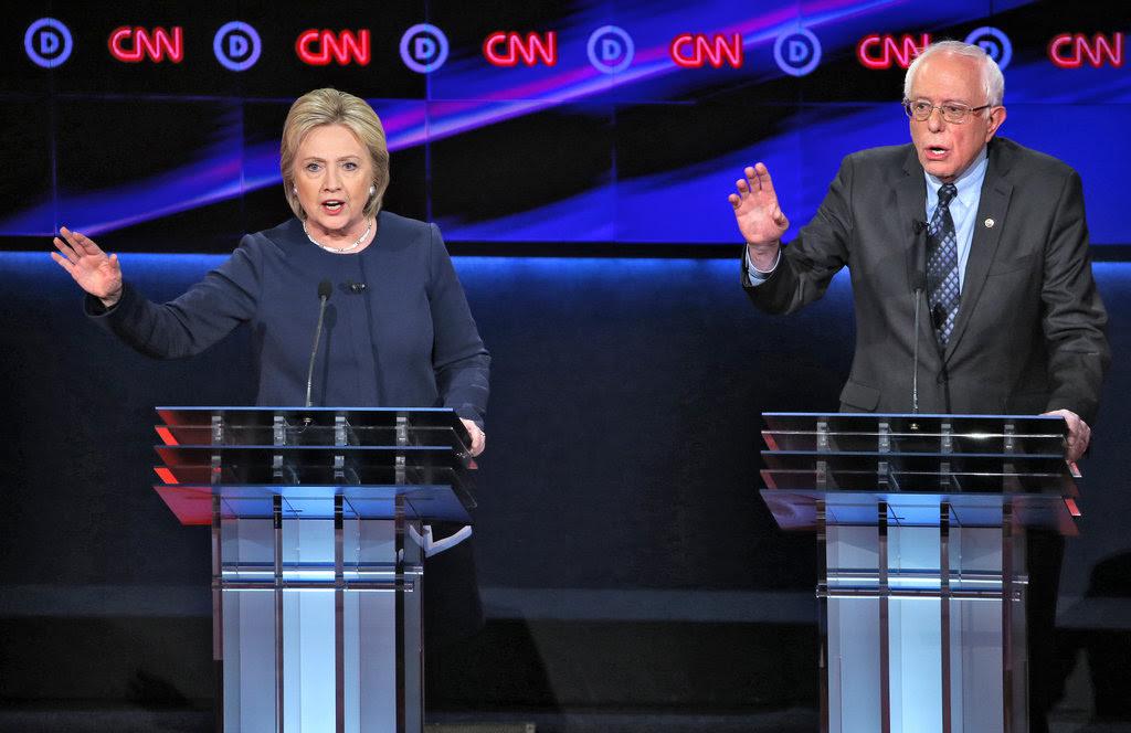 Hillary Clinton and Senator Bernie Sanders of Vermont at the Democratic debate in Flint, Mich., on Sunday night.