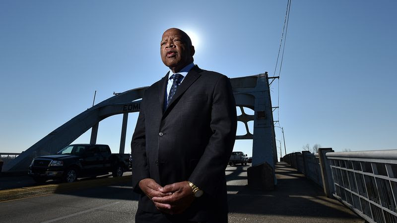 February 14, 2015 Selma, AL: Congressman John Lewis on the Edward Pettus Bridge February 14, 2015.   On March 7, 1965  Hosea Williams and John Lewis  led 600 civil rights activists across the Edward Pettus Bridge in a march for voting rights.  Lewis had no idea  the level of violence that awaited the group on the other side of the bridge. In what would become known around the country as as Bloody Sunday, state troopers and sheriff deputies used tear gas and clubs to break up the march.  Leaving Lewis with a skull fracture and sending more than 50 others to the local hospital for treatment.   BRANT SANDERLIN / BSANDERLIN@AJC.COM