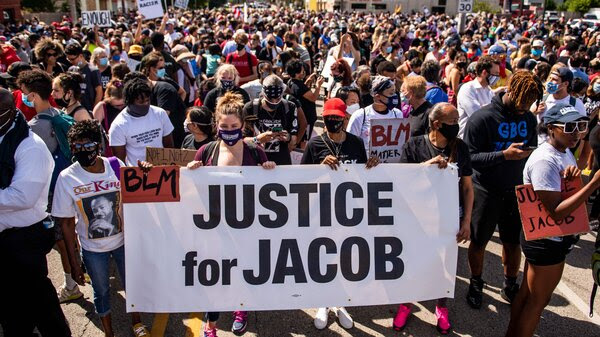 Protesters march with the family of Jacob Blake during a rally against racism and police brutality in Kenosha, Wisconsin, on August 29, 2020.