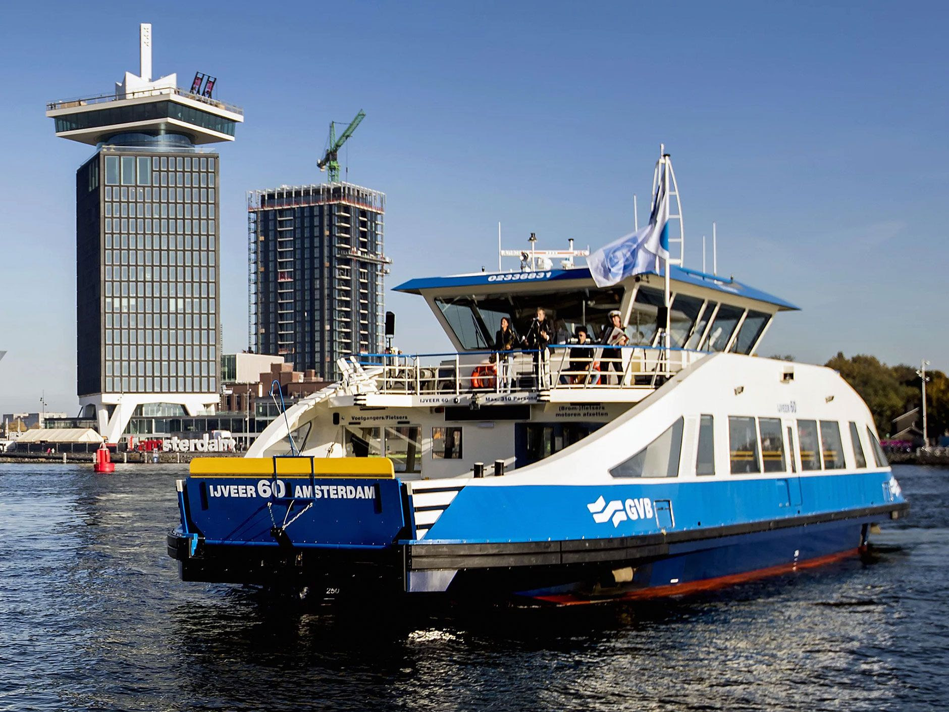 The hybrid <i>IJveer 60</i> carries passengers and cars around Amsterdam along with its sister ferry, the <i>IJveer 61</i>.