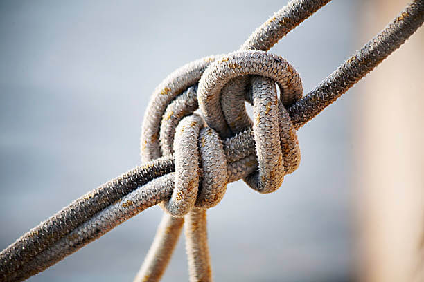 noose in a quay harbour - close up view with sea background