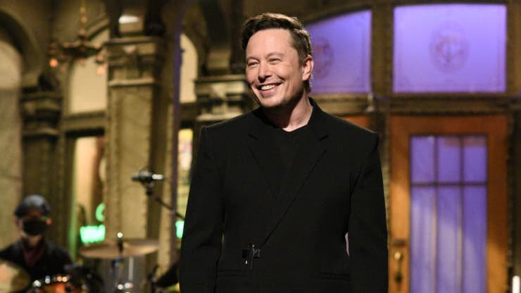 Elon Musk smiles as he hosts Saturday Night Live