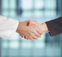 healthcare provider and businessman shaking hands