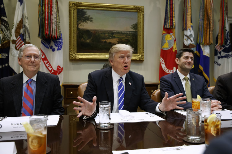 President Trump speaks at the White House,flanked by Senate Majority Leader Mitch McConnell and House Speaker Paul Ryan. (Evan Vucci/AP)