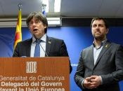 Former Catalan leader Carles Puigdemont and regional minister Antoni Comin hold a news conference in Brussels.