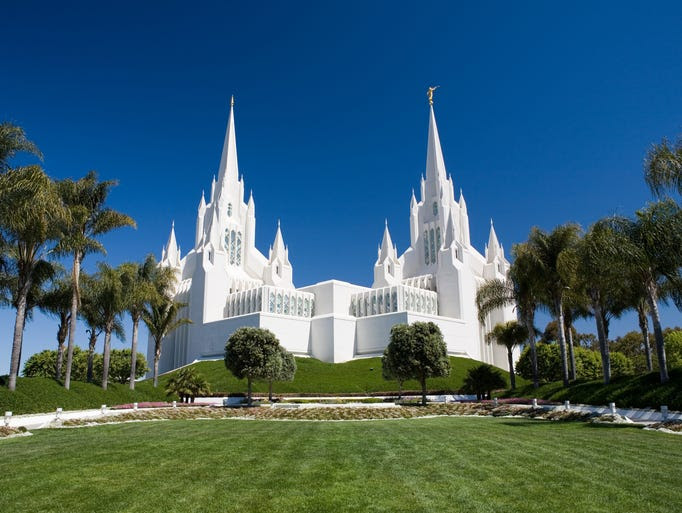 The six                                                           spires of the                                                           San Diego                                                           California                                                           Temple of the                                                           Church of                                                           Jesus Christ                                                           of Latter-day                                                           Saints appear                                                           to glow in the                                                             sun, thanks to                                                           its                                                           construction                                                           using pieces                                                           of marble set                                                           in stucco.                                                           It's even more                                                           beautiful at                                                           night when                                                           illuminated on                                                           all sides.
