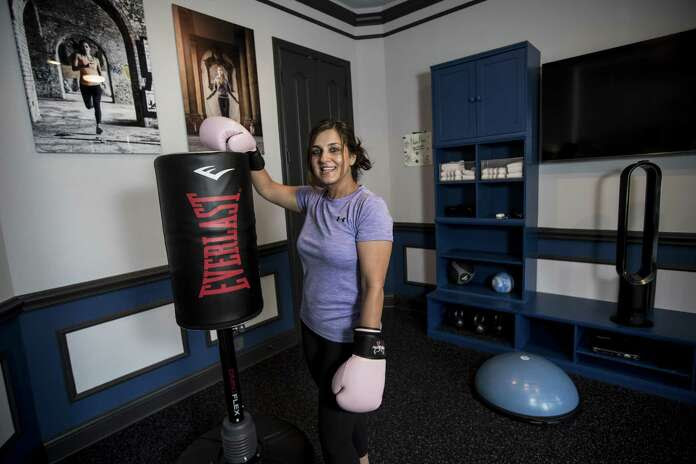 Neda Malkani poses for a portrait in her excercise room, that was once a formal dining room at her home, on Friday, June 1, 2018, in Humble. ( Brett Coomer / Houston Chronicle ) Photo: Brett Coomer, Staff / Houston Chronicle / © 2018 Houston Chronicle