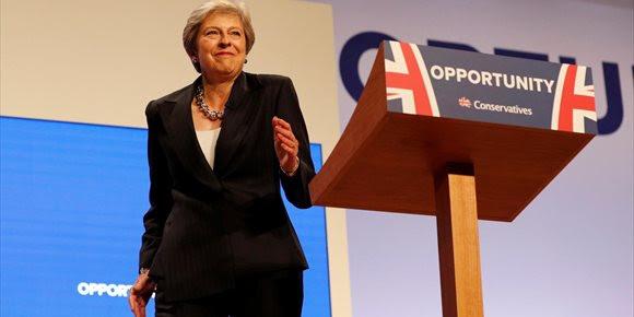 1. May advierte a sus colegas conservadores de que las divisiones internas podrían acabar con el Brexit