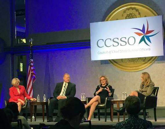 Superintendent Balow talks on a stage with the state chiefs from Florida and Illinois during a panel moderated by the Interim Director of CCSSO. A large sign hangs behind the stage that reads CCSSO Council of Chief State School Officers.
