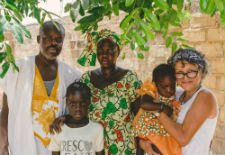 Peace Corps volunteer Karen Chaffraix and her host family in Senegal.