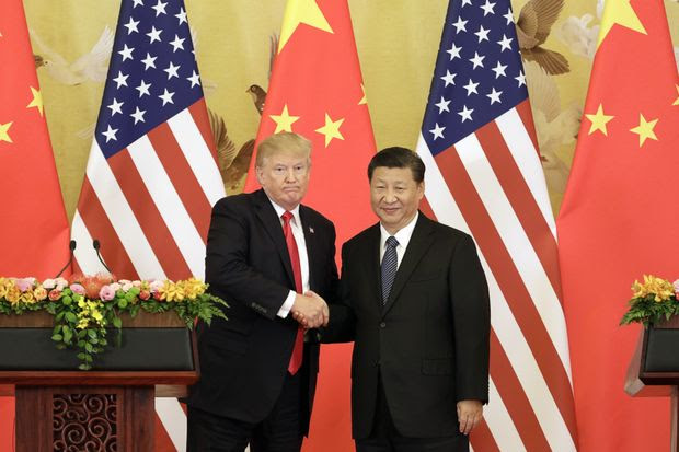 President Trump and Chinese President Xi Jinping shake hands in Beijing in November 2017. The U.S. and China are in an intensifying trade fight.