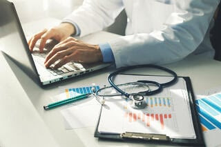 medical professional taking records of patient data