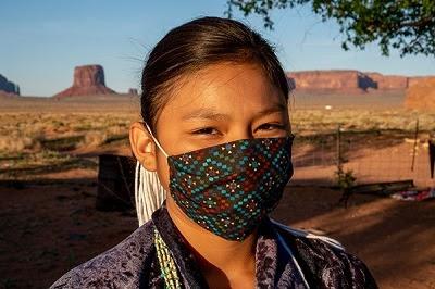 Native American girl wearing a mask