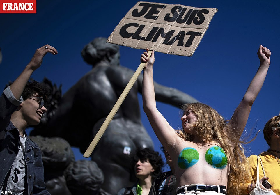 Protesters gather during a global climate strike demonstration in Paris, France