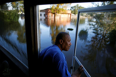 Eric McClary checked the water level in his home in Goldsboro, N.C., on Wednesday, after Hurricane Matthew caused severe flooding.