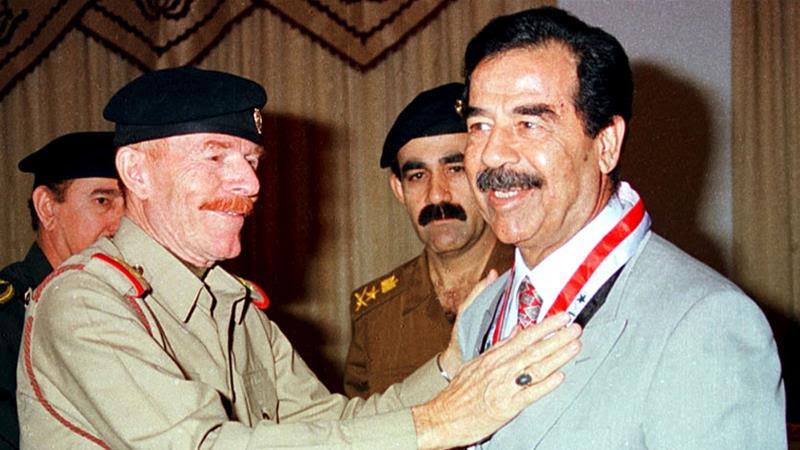 Former Iraqi President Saddam Hussein with his aid Ezzat al-Douri [File photo/Reuters]